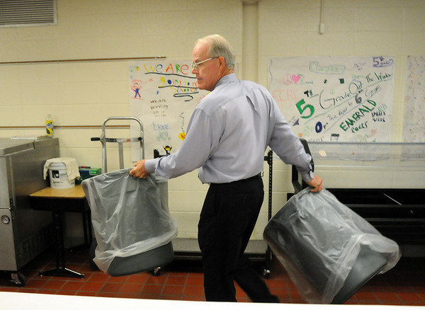 During his last day of school Emerald Elementary School Principal Larry Leathermancan't avoid the mundane duties of a principal by moving trash cans around the cafeteria during the 5th grade breakfast on Thursday.<br /> May 27, 2010<br /> Staff photo/ David R. Jennings