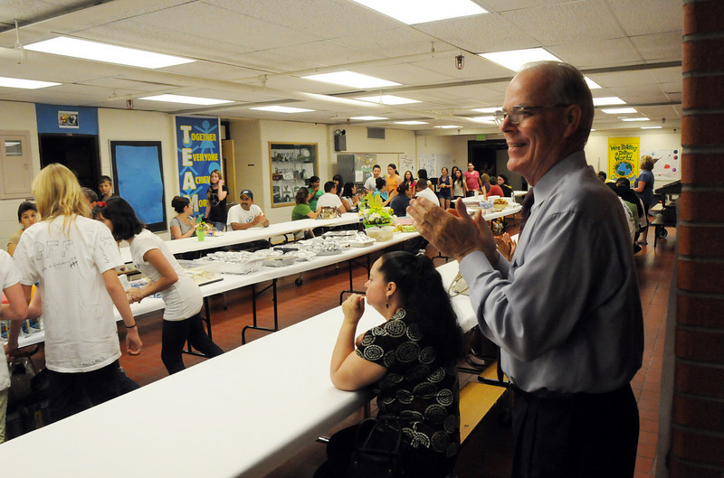 Emerald Elementary School Principal Larry Leatherman claps for the 5th graders at their breakfast on the last day of school,Thursday. Leatherman and 5 other staff members are retiring.<br /> May 27, 2010<br /> Staff photo/ David R. Jennings