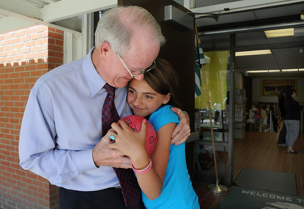 Emerald Elementary School Principal Larry Leatherman hugs and chats with fourth grader Maddie Burris during the last day of school  on Thursday. <br /> May 27, 2010<br /> Staff photo/ David R. Jennings