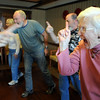 JoAnn Benter, right, does a laughter arguing exercise with the group during Laughter Yoga taught by Tomi-Ann Roberts professor of psychlogy at Colorado College for Active Aging Week at the Stratford at FlatIrons on Thursday.<br /> <br /> Sept. 24, 2009<br /> Staff photo/David R. Jennings