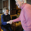 Paula Barber, left, is greeted by JoAnn Benter during the laughter greeting exercise at Laughter Yoga taught by Tomi-Ann Roberts professor of psychlogy at Colorado College for Active Aging Week at the Stratford at FlatIrons on Thursday.<br /> <br /> Sept. 24, 2009<br /> Staff photo/David R. Jennings