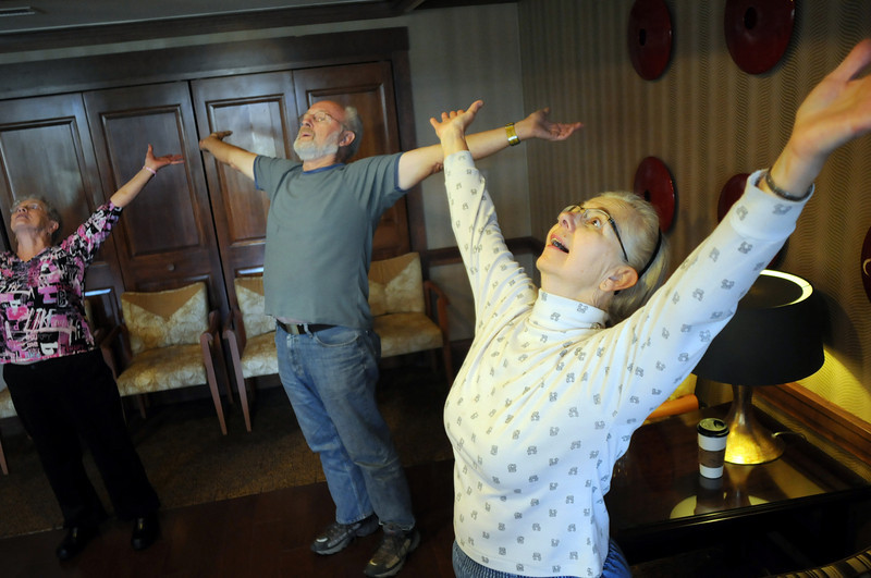Monica Van Zale, right, with her husband Joe, center and Gerry Eagleton do a wide stretch laugh during Laughter Yoga taught by Tomi-Ann Roberts professor of psychology at Colorado College for Active Aging Week at the Stratford at FlatIrons on Thursday.<br /> <br /> Sept. 24, 2009<br /> Staff photo/David R. Jennings