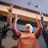 Jim Gillen, left, JoAnn Benter and Doris Bevery put their arms up and laugh during Laughter Yoga taught by Tomi-Ann Roberts professor of psychology at Colorado College for Active Aging Week at the Stratford at FlatIrons on Thursday.<br /> <br /> Sept. 24, 2009<br /> Staff photo/David R. Jennings