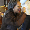 """Dorothy Jackson laughs while doing the drinking """"milk"""" exercise during Laughter Yoga taught by Tomi-Ann Roberts professor of psychology at Colorado College for Active Aging Week at the Stratford at FlatIrons on Thursday.<br /> <br /> Sept. 24, 2009<br /> Staff photo/David R. Jennings"""