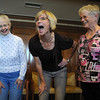 Tomi-Ann Roberts, center, professor of psychology at Colorado College, starts the laughing for no reason exercise with participants Monica VanZale, left, and Gerry Eagleton at the Laughter Yoga presentation by during Active Aging Week at the Stratford at FlatIrons on Thursday.   laughteryogainternational.org.<br /> <br /> Sept. 24, 2009<br /> Staff photo/David R. Jennings