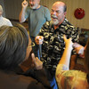 Jim Gillen, center, laughter argues with Dorothy Jackson, left, during exercise during Laughter Yoga taught by Tomi-Ann Roberts professor of psychology at Colorado College for Active Aging Week at the Stratford at FlatIrons on Thursday.<br /> <br /> Sept. 24, 2009<br /> Staff photo/David R. Jennings