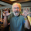 Joe Van Zale does the tiger laughter exercise during Laughter Yoga taught by Tomi-Ann Roberts professor of psychology at Colorado College during Active Aging Week at the Stratford at FlatIrons on Thursday.<br /> <br /> Sept. 24, 2009<br /> Staff photo/David R. Jennings