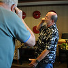 Jim Gillen, right, does the cell phone laughter exercise during Laughter Yoga taught by Tomi-Ann Roberts professor of psychology at Colorado College for Active Aging Week at the Stratford at FlatIrons on Thursday.<br /> <br /> Sept. 24, 2009<br /> Staff photo/David R. Jennings