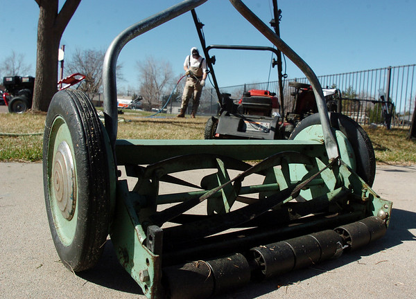 A push mower is in line to be cleaned and have the blades sharpened and adjusted while Jeff Jones washes lawnmowers at the lawnmower clinic at the United Church of Broomfield on Saturday.<br /> April 2, 2011<br /> staff photo/David R. Jennings