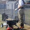 Jeff Jones washes a mower during the lawnmower clinic at the United Church of Broomfield on Saturday.<br /> April 2, 2011<br /> staff photo/David R. Jennings