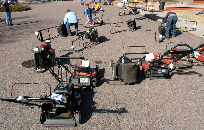 Lawnmowers are drained of oil and blades removed for sharpening during the lawnmower clinic at the United Church of Broomfield on Saturday.<br /> April 2, 2011<br /> staff photo/David R. Jennings