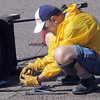 Walt McKee prepares to replace a blade on a mower during the lawnmower clinic at the United Church of Broomfield on Saturday.<br /> April 2, 2011<br /> staff photo/David R. Jennings