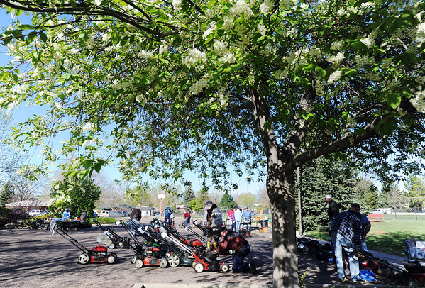 Volunteers work on some 56 lawnmowers during the United Church of Broomfield 17th annual Lawnmower Clinic on Saturday.<br /> <br /> <br /> <br /> April 14, 2012 <br /> staff photo/ David R. Jenning