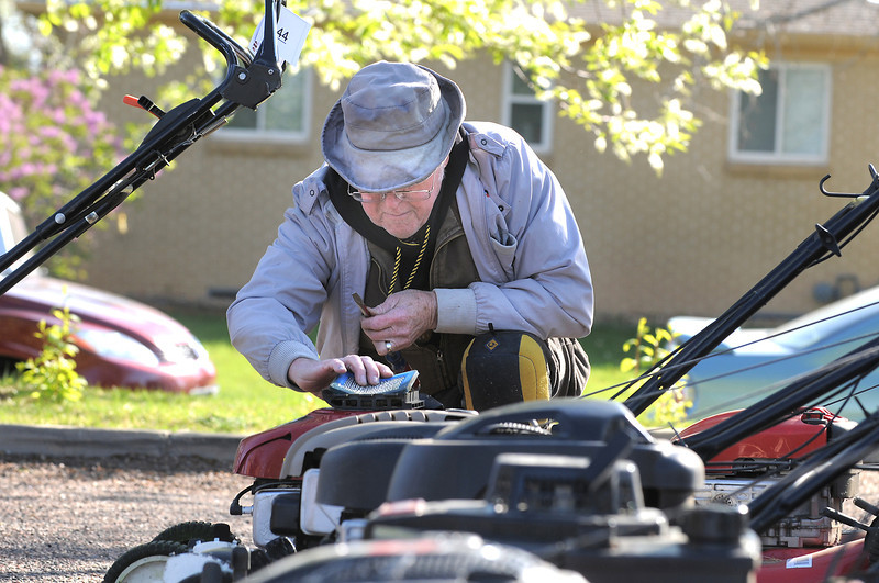 Glen Hopson changes air filters on lawnmowers during the United Church of Broomfield 17th annual Lawnmower Clinic on Saturday.<br /> <br /> <br /> <br /> April 14, 2012 <br /> staff photo/ David R. Jennings