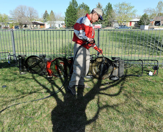 Jeff Jones poser washes lawnmowers during the United Church of Broomfield 17th annual Lawnmower Clinic on Saturday.<br /> <br /> <br /> April 14, 2012 <br /> staff photo/ David R. Jennings