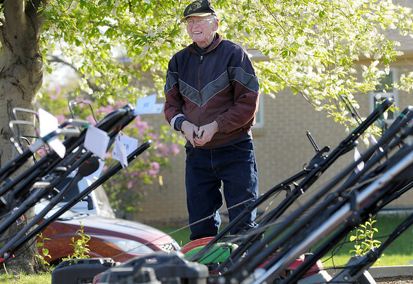 Peter Crouse works on changing air filters on lawnmowers during the United Church of Broomfield 17th annual Lawnmower Clinic on Saturday.<br /> <br /> <br /> <br /> April 14, 2012 <br /> staff photo/ David R. Jennings