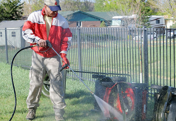 Jeff Jones power washes lawnmowers during the United Church of Broomfield 17th annual Lawnmower Clinic on Saturday.<br /> <br /> <br /> <br /> April 14, 2012 <br /> staff photo/ David R. Jennings