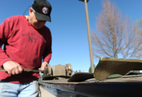 Peter Crouse sharpens lawnmower blades during the United Church of Broomfield 17th annual Lawnmower Clinic on Saturday.<br /> <br /> <br /> <br /> April 14, 2012 <br /> staff photo/ David R. Jennings