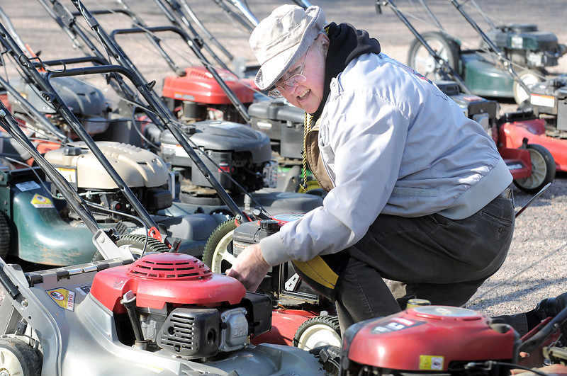 Glen Hopson changes air filters on lawnmowers during the United Church of Broomfield 17th annual Lawnmower Clinic on Saturday.<br /> <br /> April 14, 2012 <br /> staff photo/ David R. Jennings
