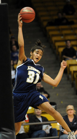 Legacy's Sade Akindele tries to keep the ball inbounds against Monarch  during the Final Four 5A game at the Coors Event Center in Boulder on Wednesday <br /> <br /> <br /> March 10, 2010<br /> Staff photo/David R. Jennings