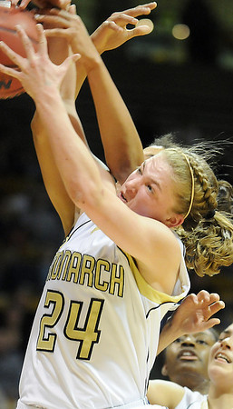 Monarch's Alex Evans fights for a rebound against Legacy during the Final Four 5A game at the Coors Event Center in Boulder on Wednesday <br /> <br /> <br /> March 10, 2010<br /> Staff photo/David R. Jennings