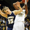 Monarch's Alexus Johnson goes to the basket colliding with  Legacy's Carli Moreland during the Final Four 5A game at the Coors Event Center in Boulder on Wednesday <br /> Monarch was defeated by Legacy 51 to 47.<br /> <br /> March 10, 2010<br /> Staff photo/David R. Jennings