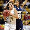 Monarch's Rebecca Richmond  goes to the basket against Legacy's Kailey Edwards during the Final Four 5A game at the Coors Event Center in Boulder on Wednesday <br /> <br /> <br /> March 10, 2010<br /> Staff photo/David R. Jennings