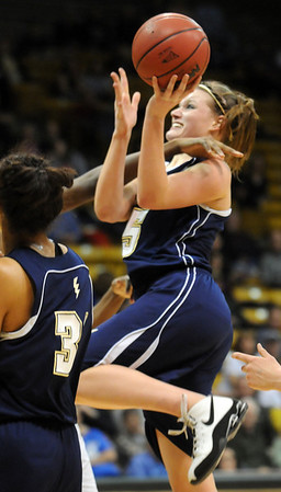 Legacy's Carli Moreland  collides with Monarch's Alexus Johnson   during the Final Four 5A game at the Coors Event Center in Boulder on Wednesday <br /> <br /> <br /> March 10, 2010<br /> Staff photo/David R. Jennings