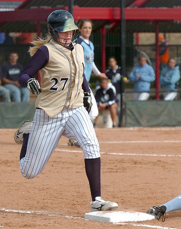 Legacy's Molly Madsen almost makes it safely to first base during in the state 5A championship softball game on Saturday at the Aurora Sports Park. <br /> October 24, 2009<br /> Staff photo/David R. Jennings