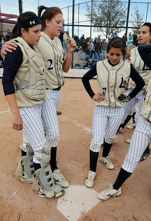 Buggs Torrez, left, and Shelby Babcock start the team in touching home plate after their third consecutive state 5A softball championship after defeating Ralston Valley 1-0 in 8 innings Saturday at the Aurora Sports Park. <br /> <br /> October 24, 2009<br /> Staff photo/David R. Jennings