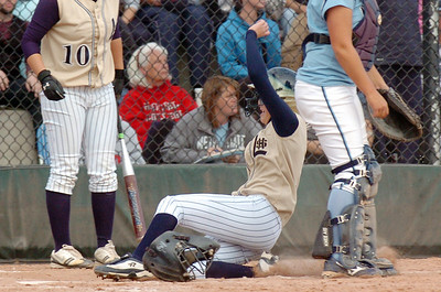 Legacy's Kaitlyn Mattila, right, slides to home to score the winning run in the state 5A championship softball game defeating Ralston Valley 1-0 in 8 innings Saturday at the Aurora Sports Park.   October 24, 2009 Staff photo/David R. Jennings