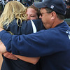 Legacy's Shelby Babcock is hugged by her parents after winning the state 5A softball championship on Saturday at the Aurora Sports Park. <br /> October 24, 2009<br /> Staff photo/David R. Jennings
