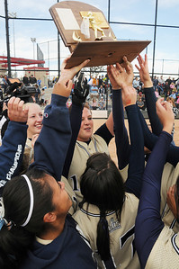 Legacy's Shelby Babcock holds up the state 5A softball trophy for the team to touch after their third state championship in a row by defeating Ralston Valley 1-0 in 8 innings Saturday at the Aurora Sports Park.   October 24, 2009 Staff photo/David R. Jennings