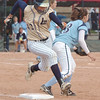 Rainey Gaffin, Legacy, beats the ball to first base past Ralston Valley's Megan Eldredge during in the state 5A softball game, Saturday, at the Aurora Sports Park. <br /> October 24, 2009<br /> Staff photo/David R. Jennings