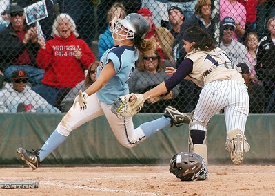 Legacy's Buggs Torrez, right, tags out Jackie Sanzolone, Ralston Valley, at homeplate in the state 5A championship softball game, Saturday, at the Aurora Sports Park.  October 24, 2009 Staff photo/David R. Jennings