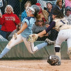 Legacy's Buggs Torrez, right, tags out Jackie Sanzolone, Ralston Valley, at homeplate in the state 5A championship softball game, Saturday, at the Aurora Sports Park. <br /> October 24, 2009<br /> Staff photo/David R. Jennings