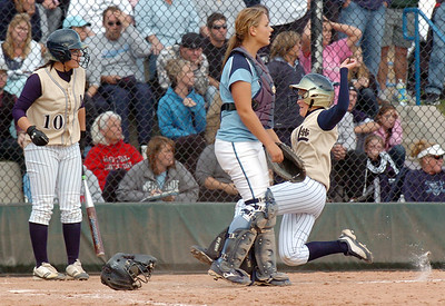 Legacy's Kaitlyn Mattila, right, slides home to score the winning run in the state 5A championship softball game defeating Ralston Valley 1-0 in 8 innings Saturday at the Aurora Sports Park.  October 24, 2009 Staff photo/David R. Jennings