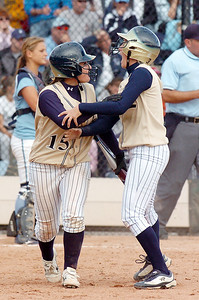 Legacy's Kaitlyn Mattila, right, is congratulated by Jessica Ball, left, after scoring the winning run in the state 5A softball game against Ralston Valley on Saturday at the Aurora Sports Park.   October 24, 2009 Staff photo/David R. Jennings