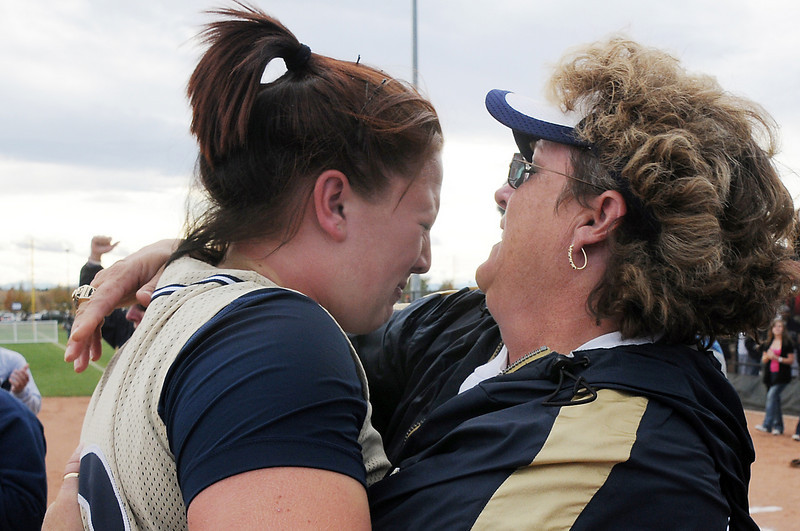Legacy's Shelby Babcock, with tears of joy, hugs coach Dawn Gaffin after winning the state 5A softball championship game defeating Ralston Valley 1-0 in 8 innings, Saturday, at the Aurora Sports Park. <br /> October 24, 2009<br /> Staff photo/David R. Jennings