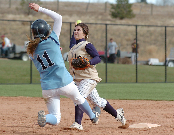Legacy's Jessica Ball, throws to first base for a double after tagging out Meaghan Murphy, Ralston Valley, during the state 5A championship softball game against Ralston Valley , Saturday, at the Aurora Sports Park.<br /> <br /> October 24, 2009<br /> Staff photo/David R. Jennings