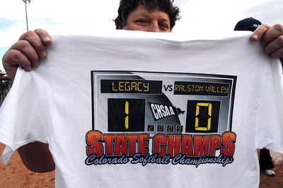 A fan holds a commemorative T-shirt showing Legacy's state 5A softball championship by  defeating Ralston Valley 1-0 in 8 innings Saturday at the Aurora Sports Park.  October 24, 2009 Staff photo/David R. Jennings