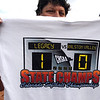 A fan holds a commemorative T-shirt showing Legacy's state 5A softball championship by  defeating Ralston Valley 1-0 in 8 innings Saturday at the Aurora Sports Park. <br /> October 24, 2009<br /> Staff photo/David R. Jennings