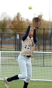 Legacy's Rainey Gaffin catches the ball in right field hit by Ralston Valley during the state 5A softball game, Saturday, at the Aurora Sports Park.  October 24, 2009 Staff photo/David R. Jennings