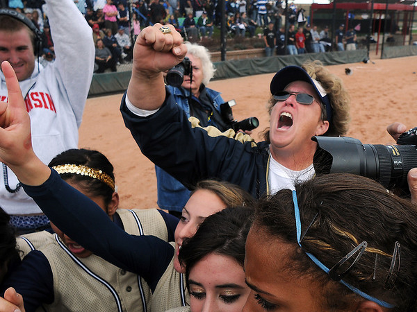Legacy's coach Dawn Gaffin leads the team in a cheer after winning the state 5A softball championship on Saturday at the Aurora Sports Park. <br /> October 24, 2009<br /> Staff photo/David R. Jennings