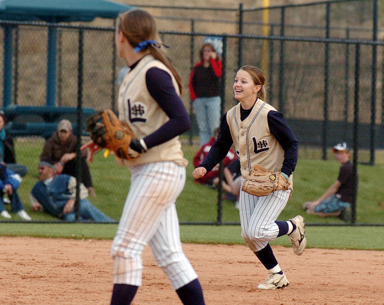 Legacy's Payton Price is all smiles after making throw from left field to home plate for an out during the state 5A softball championship game against Ralston Valley on Saturday at the Aurora Sports Park. <br /> October 24, 2009<br /> Staff photo/David R. Jennings