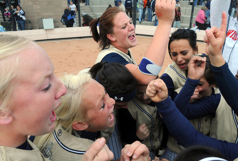 The Legacy team gives a cheer after winning the state 5A softball championship defeating Ralston Valley 1-0 in 8 innings, Saturday, at the Aurora Sports Park. <br /> <br /> October 24, 2009<br /> Staff photo/David R. Jennings