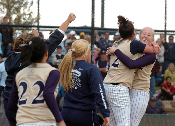 Legacy's Shelby Babcock and Molly Madsen hug each other moments after winning their third consecutive state 5A softball championship by defeating Ralston Valley 1-0 in 8 innings Saturday at the Aurora Sports Park. <br /> <br /> October 24, 2009<br /> Staff photo/David R. Jennings