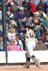 Legacy's catcher Buggs Torrez catches a foul ball during the state 5A championship softball game  against Ralston Valley on Saturday at the Aurora Sports Park.  October 24, 2009 Staff photo/David R. Jennings