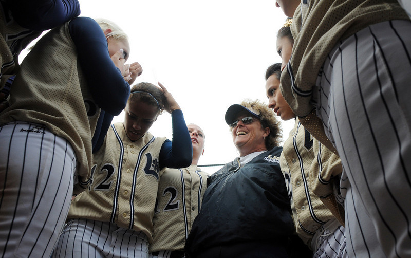 Dawn Gaffin, Legacy's coach, center,  talks to the team after they won their third consecutive state 5A softball championship by defeating Ralston Valley 1-0 in 8 innings, Saturday, at the Aurora Sports Park. <br /> October 24, 2009<br /> Staff photo/David R. Jennings