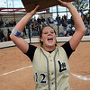 Legacy's Shelby Babcock holds up the state 5A softball trophy for the team to see after winning their third state championship in a row by defeating Ralston Valley 1-0 in 8 innings Saturday at the Aurora Sports Park. <br /> <br /> October 24, 2009<br /> Staff photo/David R. Jennings